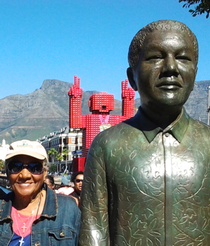 Stevenson next to a statue of Nelson Mandela during South Africa tour.