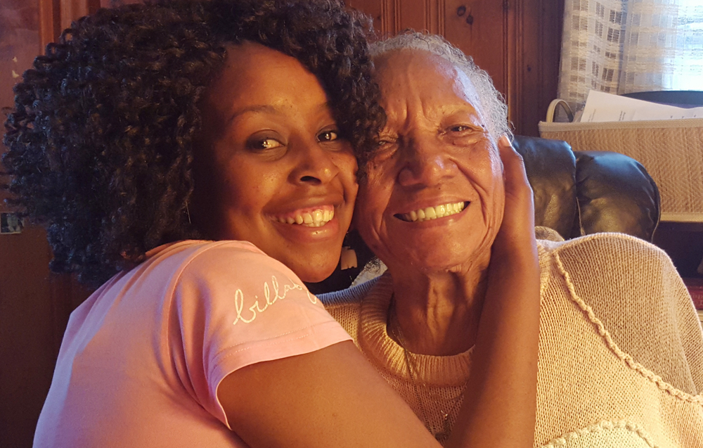 Portia Motsapi gives Sarah Stevenson a hug at Stevenson's home on Aug. 24, 2015. For two years Portia has been working to raise funds to get to the United States, while Stevenson has been focused on raising tuition money in Charlotte to help the South African student achieve her dream of attending Johnson C. Smith University. Motsapi arrived Saturday and was scheduled to begin classes at JCSU this week.