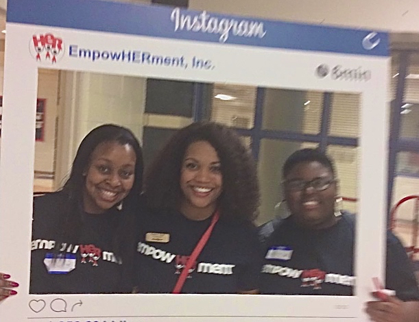 Motsapi with EmpowHerment Executive Director Carrie Cook and Lanae' Brown at Phillip O. Berry Academy of Technology.